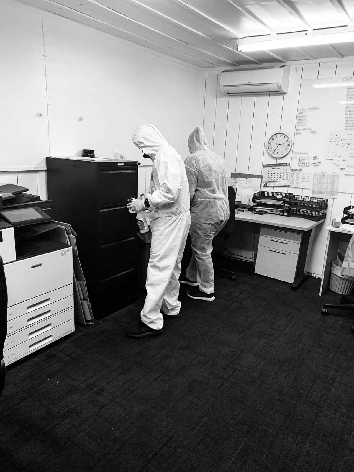 RAMS Cleaning Services team applying the Covid-19 Sanitisation Process at a workplace